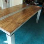 Walnut and glass blasted stainless steel dining table