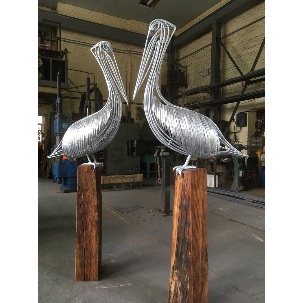 forged steel pelicans on reclaimed oak plinth