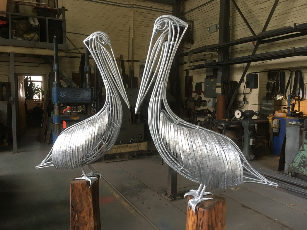 forged steel pelican sculptures