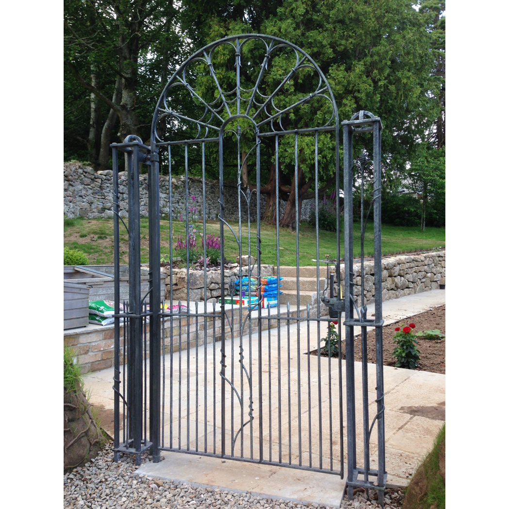 traditionally forged garden gate with pillars