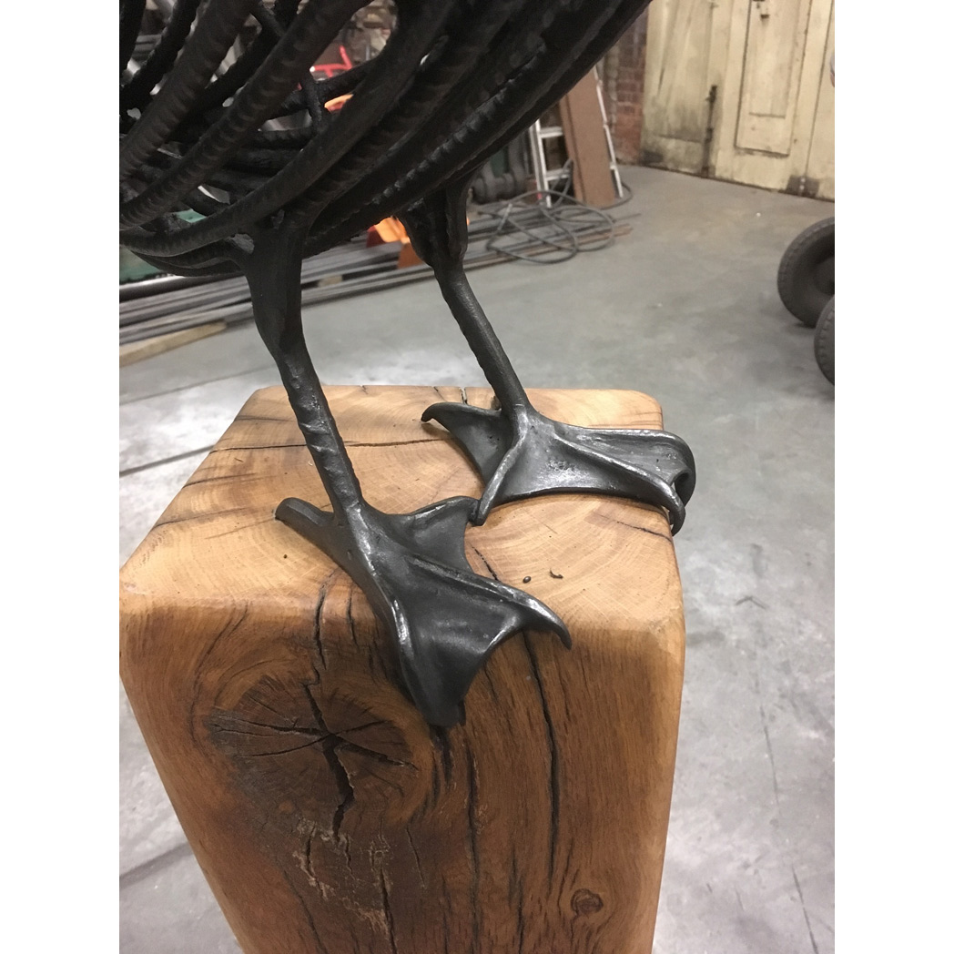 cormorant sculpture in blackened steel , feet detail